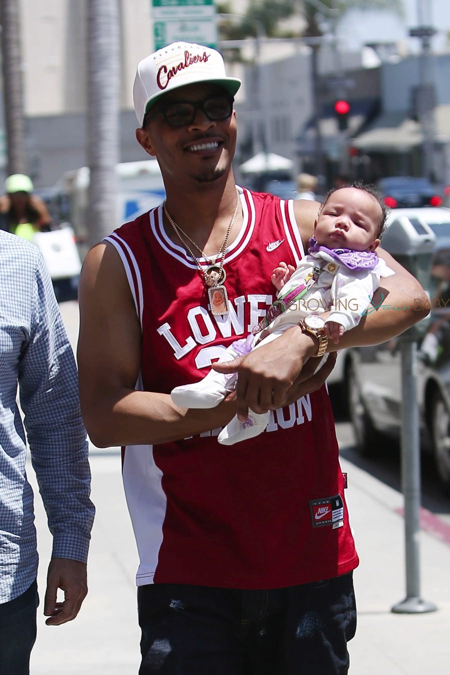 TI Cradles His Beverly Hills Baby