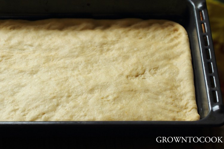 spreading the dough on the baking sheet