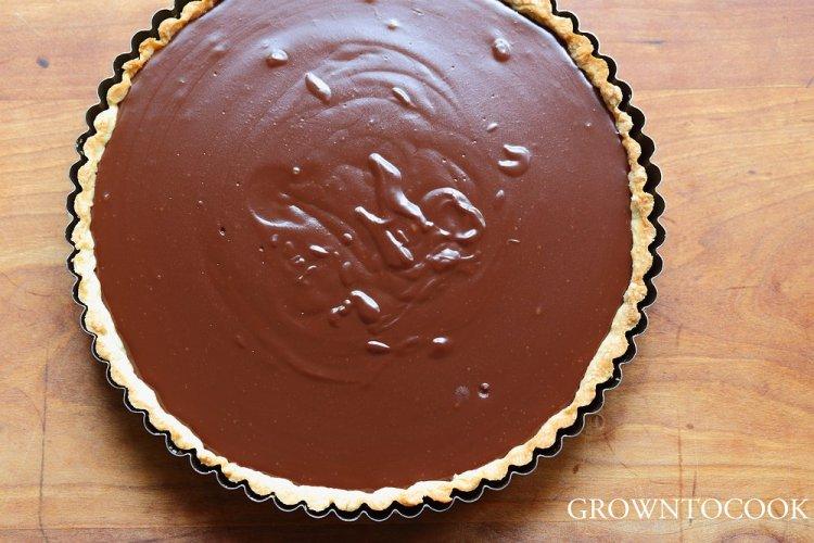 milk chocolate sesame cream tart with cherries