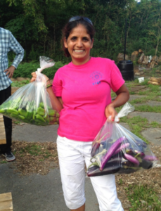 Januka Regmi, manager of SHIM's Whitehall Peace and Community Garden
