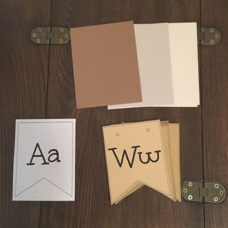 alphabet cards on wood table with colored paper