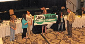 Members of the Organic Consumers Association held a protest at the recent National Organic Standards Board meeting in San Antonio, TX. photo via Food Safety News