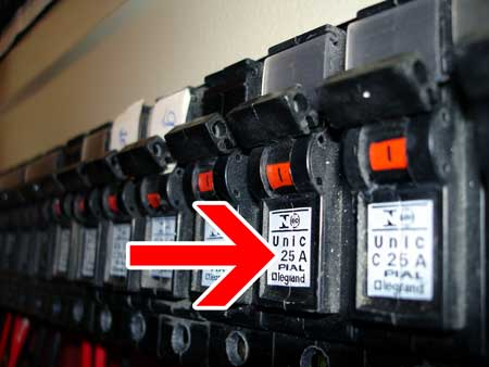 Check your circuit breaker box to see what Amps it can support, so you can figure out how many watts are safe to put on each circuit