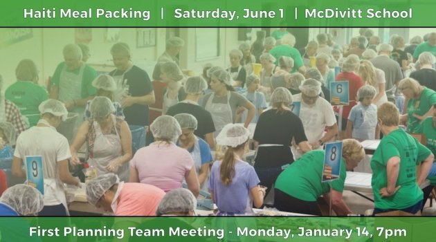 Community Volunteers Packing Meals for Haiti