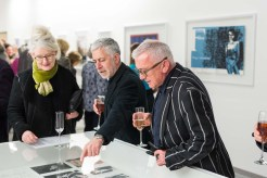 GSA alumni admire the material and share stories. Image courtesy of © McAteer Photograph.