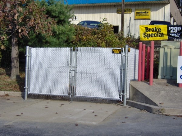 Dumpster Enclosure with White Privacy Slat Inserts