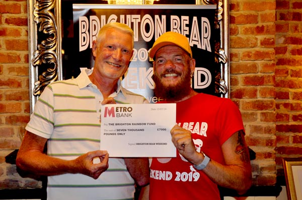 Steve Beaumont from Rainbow Fund receives cheque for £7,000 from BBW