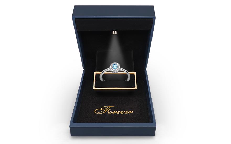 Verlobungsring aus Weigold mit Topas und Diamanten 0100
