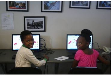 eduvate-pic-of-kids-and-computer
