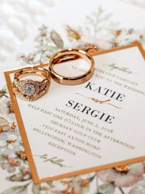 rose gold bellingham wedding invitation and rings