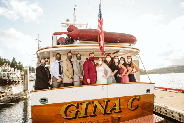 mask wearing wedding party during a covid wedding at port orchard marina in washington state