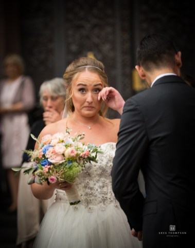 The bride has tears in her eyes after the marrige ceremony.