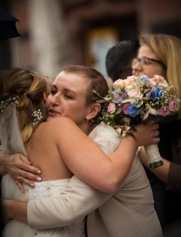 Bride hugging well wishers.