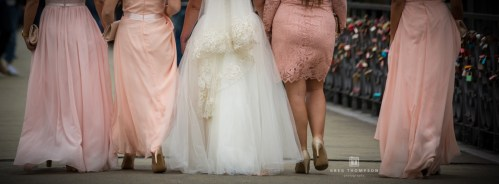 Bride and bridesmaids crossing the river Main on Eiserner Steg