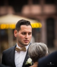 One of the grooms groomsmen mingling with guests.
