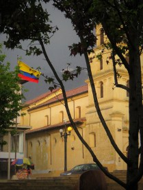 A church near the Museo Botero with Monserrate visible in the background
