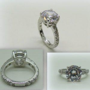 Anello solitario su fedina circolare in argento 925 e zirconi