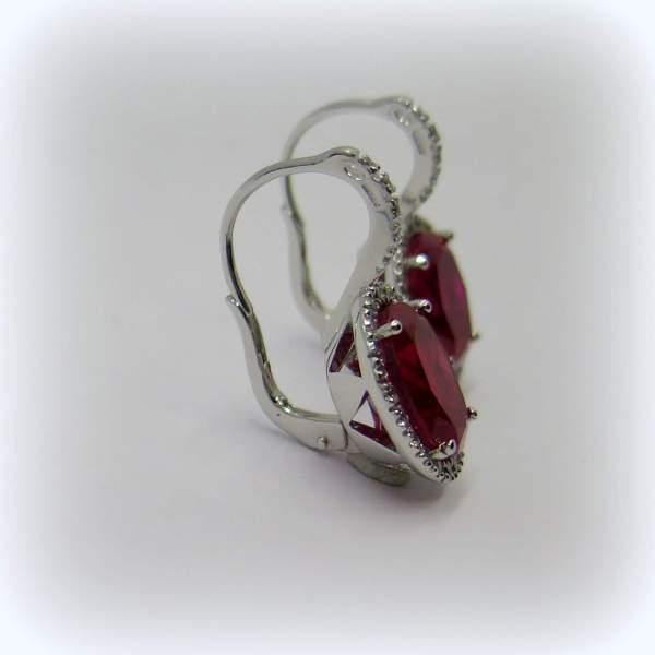 Orecchini pendenti pietra rossa ovale contorno in argento 925