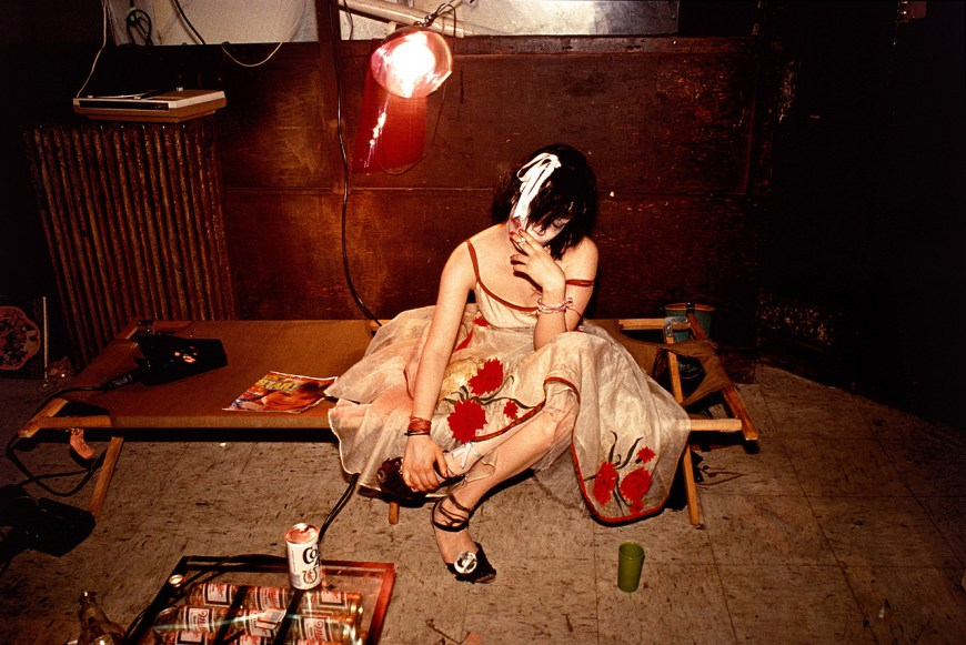 Nan Goldin, Trixie on the cot, NYC, 1979. Silver dye bleach print, image: 25 3/4 x 38 3/8 inches (65.4 x 97.5 cm); sheet: 27 1/2 x 40 inches (69.9 x 101.6 cm)