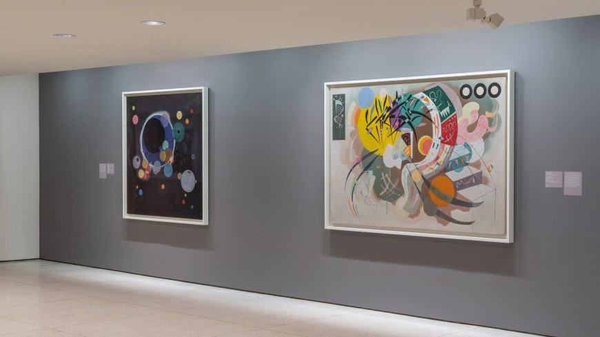 Two Vasily Kandinsky abstract paintings: Several Circles, with circles on a black background, and Dominant Curve, with biomorphic forms in pastel hues