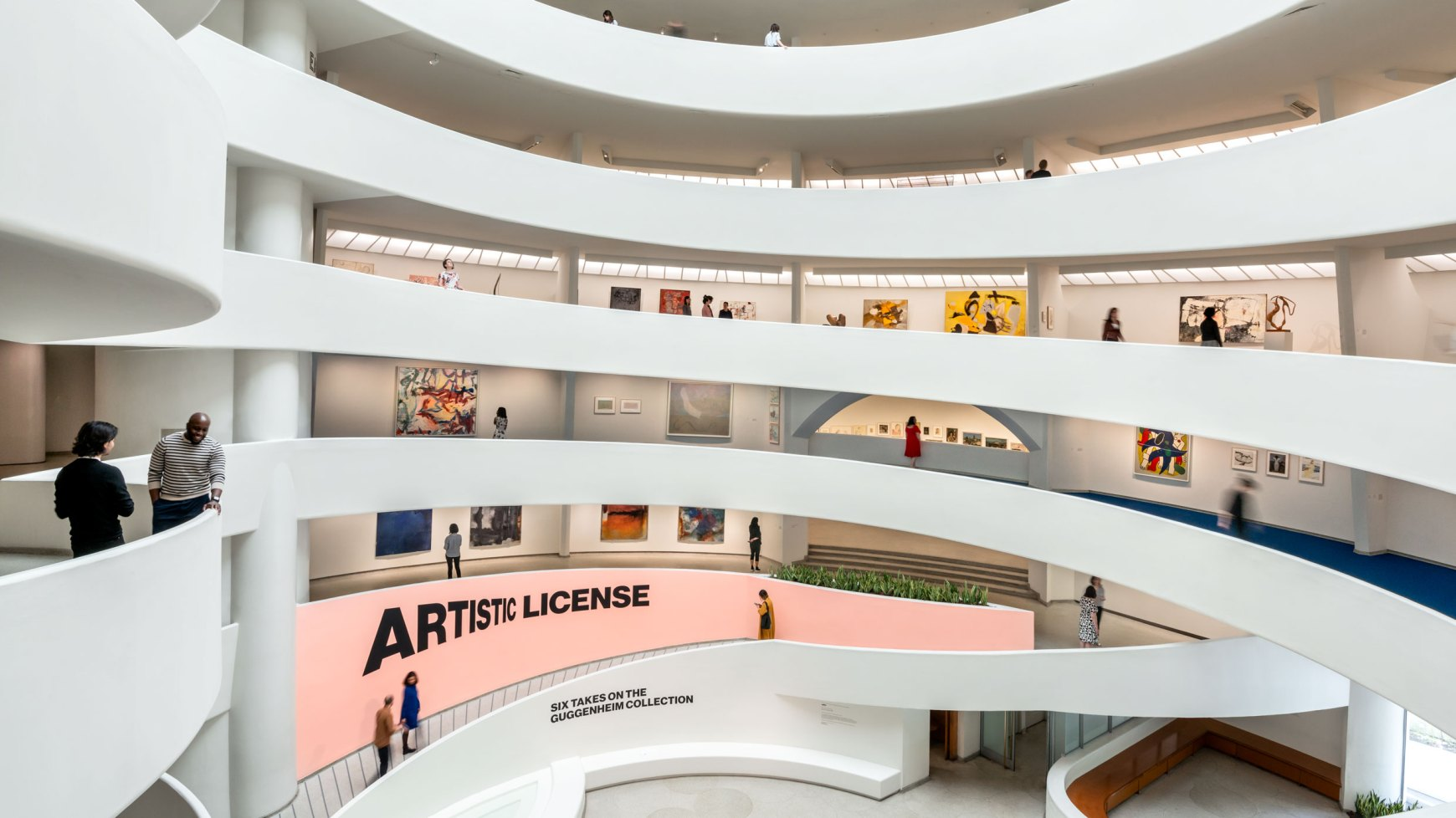 Visitors looking at art inside the Guggenheim Museum