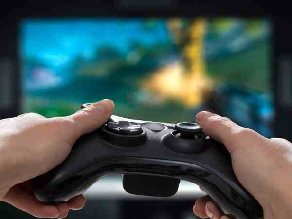 gaming game play tv fun gamer gamepad guy controller video console playing player holding hobby playful enjoyment view concept – stock image