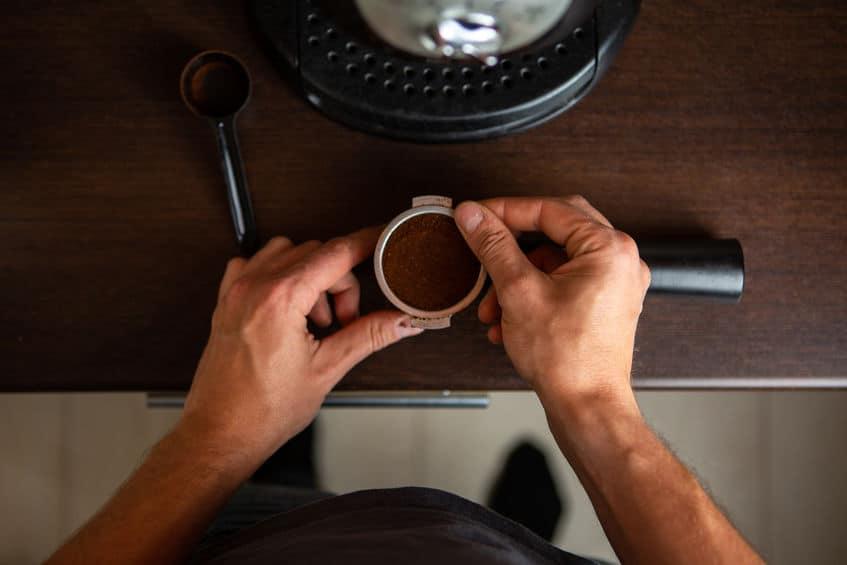 Person preparing coffee.