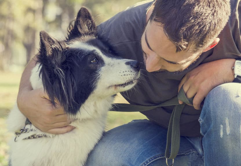 Image of dog and its owner.