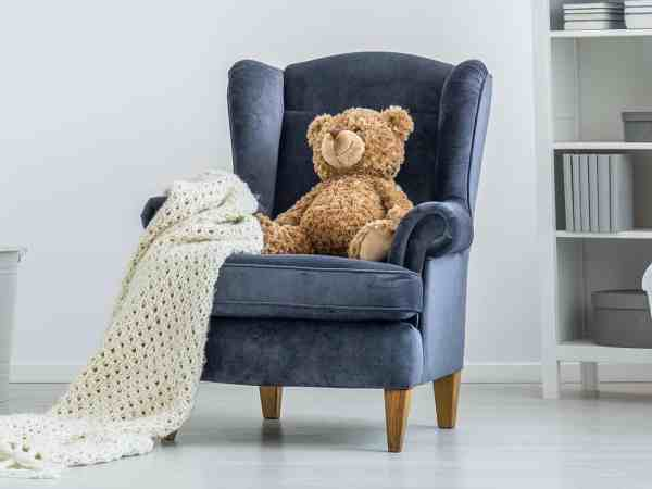 toddler couch with a teddy bear