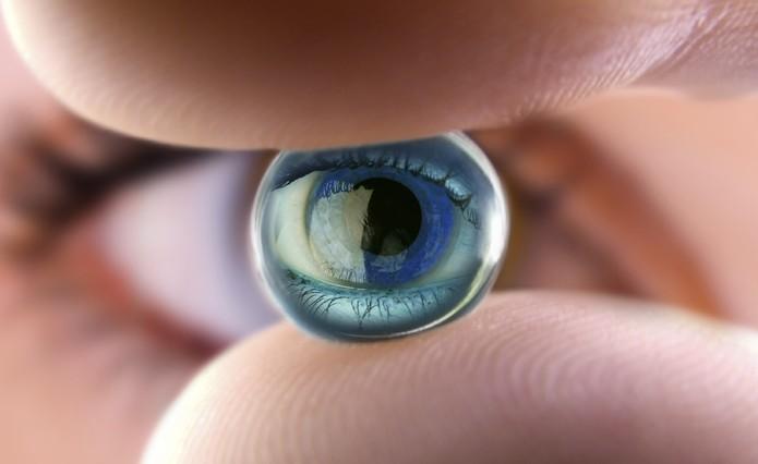 Small gel marble reflecting a woman eye. Macro shot.