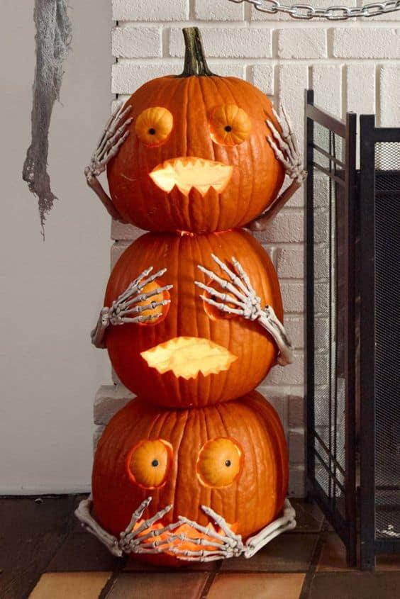 Tris di zucche intagliate per Halloween