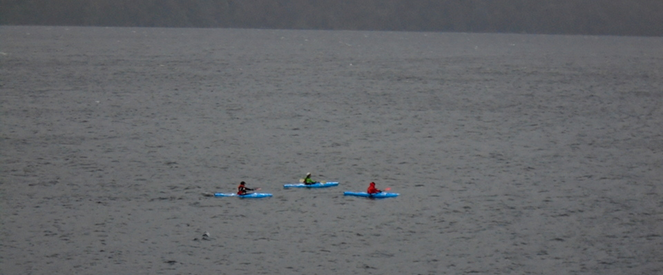 Canoes from the Governor's Rock headland