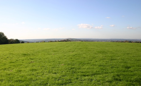 View Westwards from Landing Ground with the end of the Hog's Back in the centre and Guildford Cathedral to the right.
