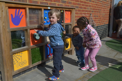 At the Spinney Children's Centre There is a wall full of curiosities with something to touch, something to grab and something to open.