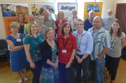 Community warden Tracy James (centre) with some of those who attended the Grassroots Marketplace on Thursday, June 18.