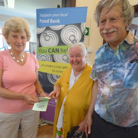 Ann Mather of the North Guildford Foodbank with Cllr Liz Hopper and her husband, Philip.