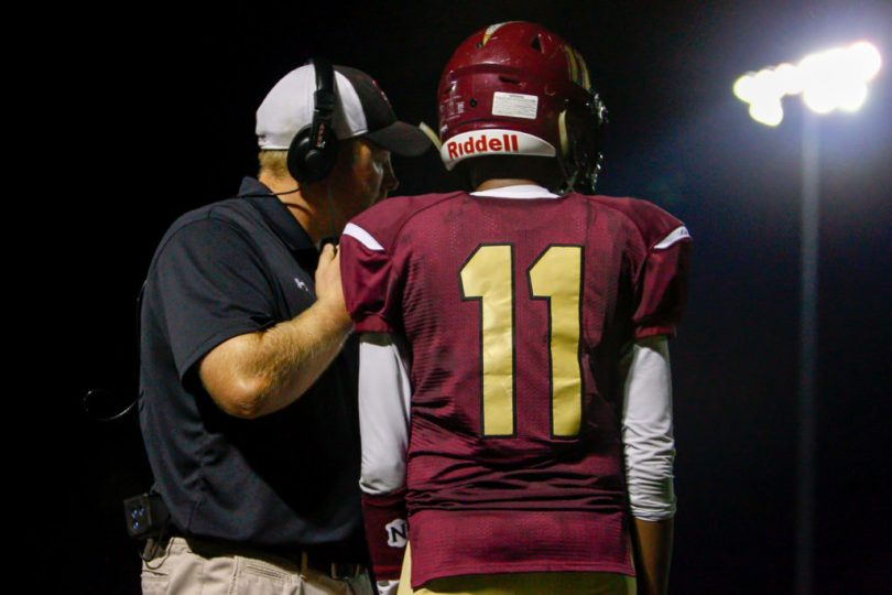 Hammond Golden Bear Head Coach Shawn Frederick calls a play while quarterback Elijah Lindsey listens during the second half of a 44-0 loss to the Glenelg Gladiators Friday at Hammond High School.  Photo by YANAIR PHOTOGRAPHY.