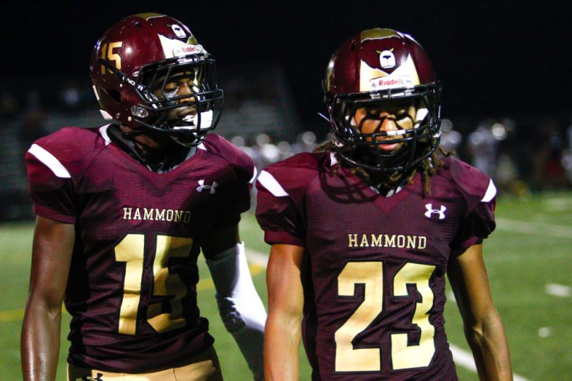 Hammond Golden Bear football players Kirkland Wise (left) and Paskel Cheeves head toward the HHS sideline in the third quarter of Glenelg's 44-0 victory at Golden Bear Stadium Friday evening. Wise caught two passes for 45 yards. Cheeves intercepted a Glenelg pass in the second quarter.  Photo by  YANAIR PHOTOGRAPHY.