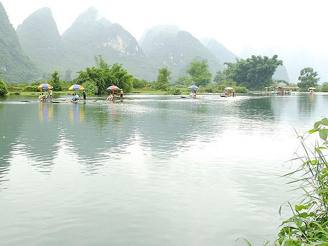 Bamboo rafting along picturesque Yulong River, Yangshuo