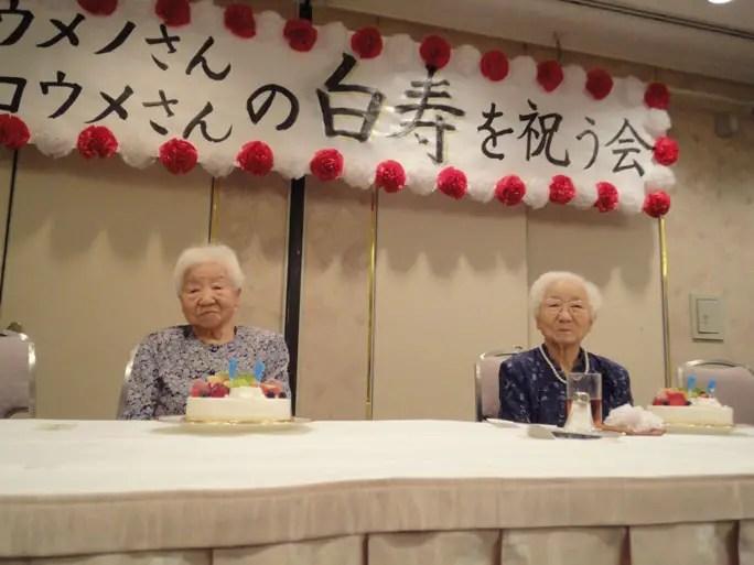 Koume (left) and Umeno (right) celebrating their 99th birthday