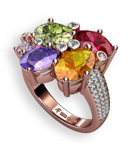 läcker ring i roseguld med färgsprakande ädelstenar