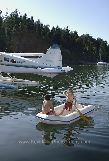 Dinghy and float plane at the Thetis Island Marina, British Columbia, Canada