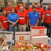 Plant Crist employees gather donations for the Manna Food Bank.