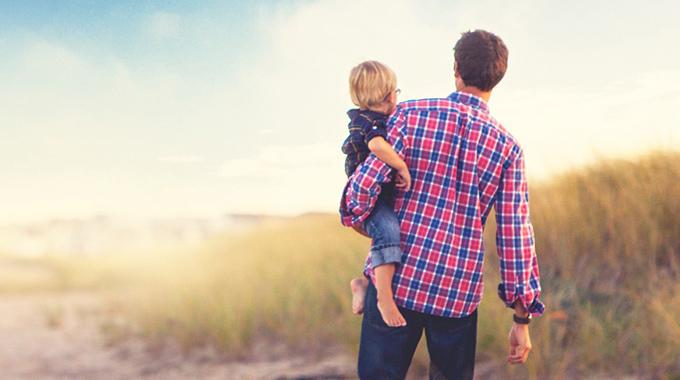 Gum Branch Baptist Church - Man Holding Toddler Boy on a Beach