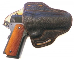 D.M. Bullard's exotic holster is a beauty,  but also note the reinforced belt loops and  double stitching. It is made to last and withstand  the many repetitions needed to achieve real speed  and smoothness in practice.