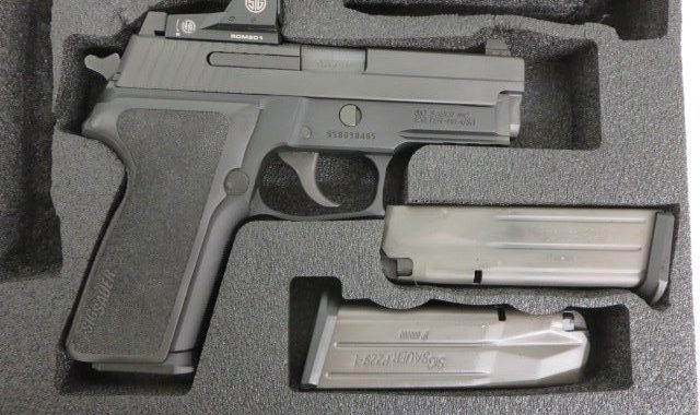 Used Sig Sauer P229 9mm RX w/ Romeo red dot, extra magazine