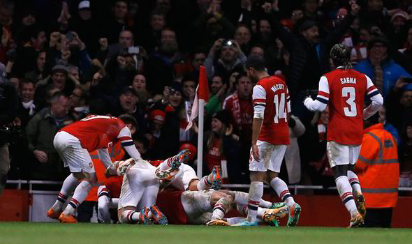 Rosicky is mobbed by team mates