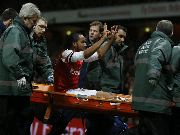 Theo Walcott carried off with an injury that would rule him out for 6 months