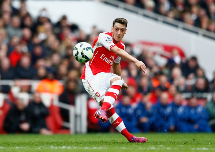 Özil slots a free kick against Liverpool