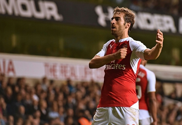 Flamini celebrates in front of the away fans